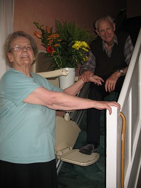 Mr and Mrs Lucas enjoying their stairlift