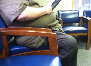 obese man in doctors surgery